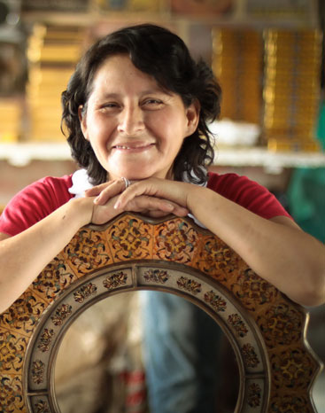 Asunta Pelaez proudly poses with one of her mirrors